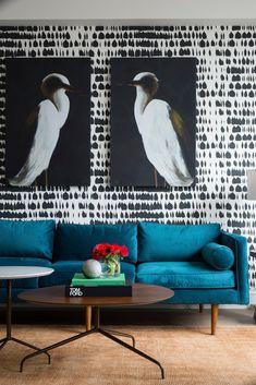 oversized art, velvet sofa, patterned wallpaper