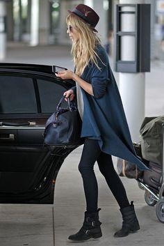 Clemence Poesy. plum panama hat. grey kimono sweater. black leggings. black moto boots.
