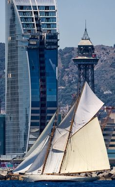 Beautiful image of one of our classics sailing in front the W Barcelona Hotel during the last Edition of the Puig Vela Clàssica Barcelona Regatta.