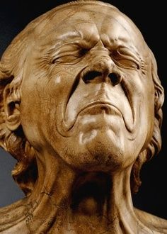 Austrian artist Franz Xaver Messerschmidt 1700's -- I think this is bronze, not clay.