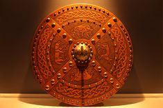 This gorgeous targe was commissioned to give as a wedding gift. It features four Pictish animals surrounded by Celtic knot work with the cross of St. Andrew filling the center. The boss is hand hammered and etched with Celtic knot work. The 8 inch brass spike is also removable. - See more at: http://www.celticleatherworks.com/the-walker-targe/