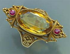 NEO~ GOTHIC RING IN THE MANOR OF LOUISE WIESE GOLD, CITRINE AND RUBY LENGTH 3.3 cm width 21 ( LENGTH 1.3in) FRENCH CIRCA 1800 FITED CASE LITERATURE ; cf. THE BELLE ÉPOQUE OF FRENCH JEWELRY 1850~1910 THOMAS HENEAG & CO LIMITED , 1990