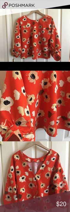 Zara poppy red floral blouse w/ low v-shaped back Zara poppy red floral blouse w/ low v-shaped back; button up back; size L; 90% polyester, 10% elasthanne Zara Tops Blouses