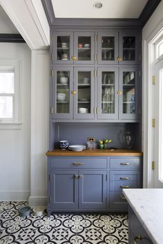 """""""Although we designed all the cabinetry in a traditional style, the homeowners insisted on a very clean line,"""" Nastasi says of the built-in storage throughout the r"""