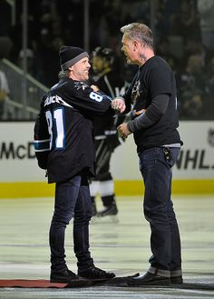 Lars Ulrich and James Hetfield of Metallica on the ice at Metallica Night At The San Jose Sharks Game on January 21, 2015 in San Jose, California