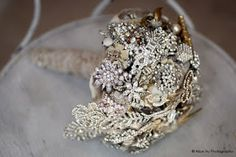 "OK ... you've been hearing about ""brooch bouquets"" for a couple of months now ... but what the heck are they?  A hand-full of VINTAGE BLING-Y GOODNESS, that's what!   Can have all vintage jewelry, or mix it up with the additional of real or faux flowers.   The best news?  If this is the look you're going for, you have a built-in excuse to visit antique and thrift shops and fairs as much as you want!    They look so traditional ... but so NOW ... and just maybe SO YOU!"