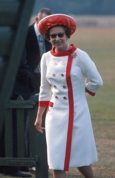 Proving her penchant for contrasting hems once again, the Queen sported a cool white-and-red look complete with a matching hat to attend a polo match in Windsor, England.