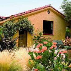 Garden Designs Ideas 2018 : Unthirsty easy-care plants, including Mexican feather grass, blue hibiscus, New Zealand flax, and orange pincushion create drama while star jasmine frames the gate of this Spanish colonial rivival home. Mexican Garden, Spanish Garden, Mediterranean Garden, Moroccan Garden, Low Water Landscaping, Front Yard Landscaping, Landscaping Design, Backyard Patio, Mexican Feather Grass