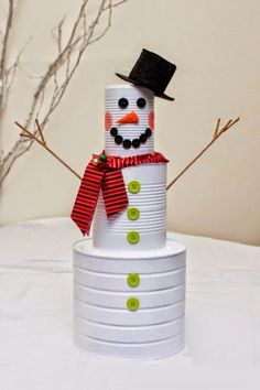 Tin Can Snowmen diy craft crafts easy crafts diy ideas diy crafts kids crafts winter crafts snowmen crafts for kids Christmas Decor Diy Cheap, Snowman Christmas Decorations, Easy Christmas Crafts, Snowman Crafts, Christmas Snowman, Christmas Projects, Simple Christmas, Christmas Holidays, Christmas Ornaments
