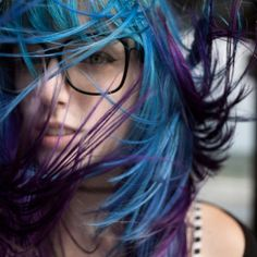 Eeep! Its cosplay coloured hair with geeky oversize glasses and a reticent look. All the things!