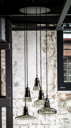Smoked glass lighting in a collection of shapes and sizes, manufactured by Brokis