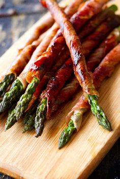 Bacon wrapped asparagus: Preheat oven to 400  Divide asparagus into bundles of 3-4 spears  Wrap each in a slice of bacon  In a saucepan  melt a stick of butter  1/2 c. brown sugar  1Tbspn soy sauce  1/2tsp garlic salt  and 1/4 tsp black peppe and bring to a boil.  Pour mix over bundles and bake until bacon looks done..