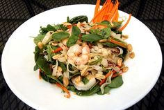 Sunrise Bistro prepares Sunrise Noodle Bowl, which has rice noodles, spinach, onion, carrots, peanuts, sweet chili sauce and watercress.