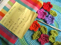 Teeny Tiny flowers from Attic 24.  Great website ... Lovely, colorful photos and crochet instructions.  Love her writing, too.