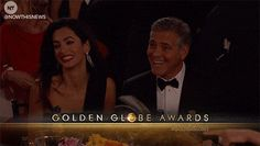 George excitedly flipped a book. | The 22 Most Important Things That Happened At The Golden Globes