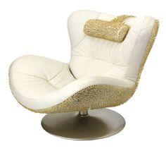 Furniture Fashion.  Natuzzi Sound Chair updated with gold screws by industrial designer David Bianchi.