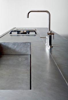 Concrete recessed sink; note drain