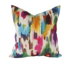 The abstract ikat pattern on this pillow cover has the look of a watercolor artists brush strokes. Colors include sky blue, turquoise, navy blue, hot pink, purple, kelly green, emerald green, brown, rust, red, maroon, orange, yellow, and gold, on a natural linen background.  Watercolor Abstract coordinates beautifully with lots of other fabrics in my shop. See below for links!  CHOOSE FROM THE DROP-DOWN MENU: - Size (other sizes available by request) - Whether you prefer the spots to run…