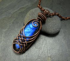 Criss Cross Wire Wrap in copper over Labradorite.