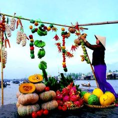 Selling agriculture products at floating market in Mekong delta, South Vietnam