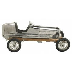 The 1930s saw the rise of hand built model racecars, known as spindizzies or tether cars. Miniature racecars built by hobbyists zoomed around banked wooden tracks at speeds approaching 150 miles per hour. Resembling the full-size racers of their day, several spindizzies competed at once, tethered by cables to a central pole. Powered by model airplane engines, spindizzies raced against the clock. Incredibly detailed and aerodynamic, these miniature racecars were beyond toys