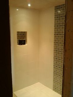 Walk-in shower now with tiles! Andalucia Morena from Fired Earth with Topps Tiles white