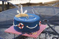 Blue fondant nautical themed birthday cake