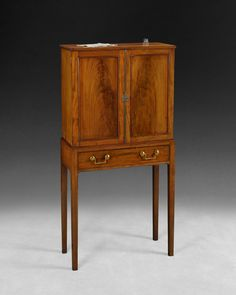 Beautiful on the outside and full of tiny drawers on the inside, this George III Mahogany collector's cabinet might be the solution for your collection!