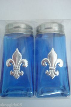 NEW! BEAUTIFUL FLEUR DE LIS SALT AND PEPPER SHAKERS WOULD LOOK GREAT IN YOUR KITCHEN. COLORS ARE BLUE WITH SILVER TOP AND FLEUR DE LIS. NICE!!