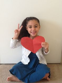 """Took picture of daughter hold heart saying """"I love you"""" and turned it into stamps for my family."""