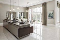 EXTREME High Gloss Luxury Kitchen Island and Dining Area