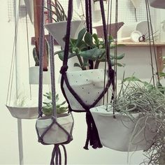 regram @harrietelkerton A close up of the hanging jungle at Top Drawer. Can you spy the new pieces being launched this year?  Find these hanging planters and vases on the @design__factory stand C-H28 @topdrawerlondon 15th-17th January 2017  #craft #handmade #ceramic #porcelain #perforated #leather #macrame #hangingplanter #hangingvase # planter #succulent #cactus #airplant #green #white #new #sneakpeek #spring
