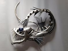 Made from old car hubcaps/wheel trims by Hubcapcreatures