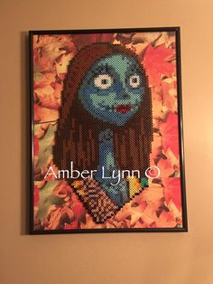 So here is my most recent Perler Portrait. This one took three times as long as my others...Her coloring was beyond challenging but I did my best so I'm happy with the results. I recolored he...