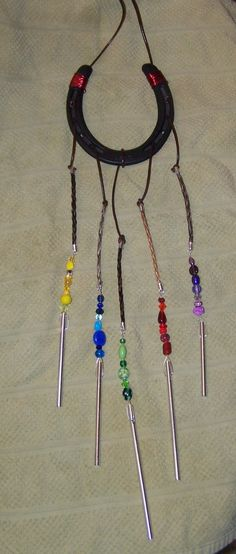 Wind chimes!  Made with varying colors of horsehair and beads.  This is a new creation for me.  Beads and hair can come in any color or combination of colors.