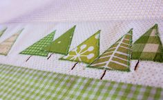 Hand made tea-towels with appliqued trees and gingham - sweet!
