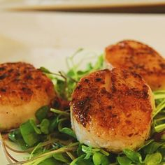 Serve the scallops right away.