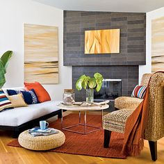 Reclaimed wood flooring warms the space while a mix of fabrics in complementary hues add splashes of color. | Coastalliving.com