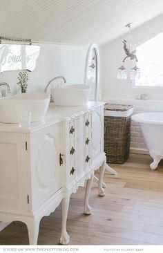 Love vintage furniture repurposed into vanities.   The dual vessel sinks are amazing!