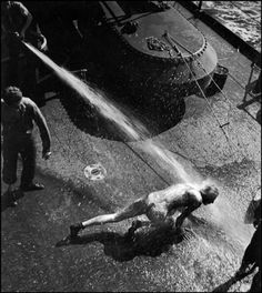 65 Magnum Photos Nudes in Auction @ Sotheby's    W. Eugene Smith – From Pollusog to Shellback. A crew member being hosed aboard the USS Bunker Hill aircraft carrier (the ritual initiation when crossing the equator for the first time). World War II, The Pacific Campaign (1943)    © W. Eugene Smith/Magnum Photos