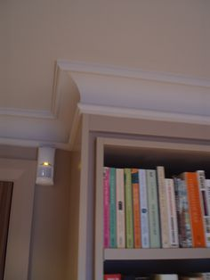 Detail of plaster cornice around the top of cabinets / study