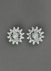 Starburst crystal earring with a light imitation rhodium plating is the perfect, simple addition to any look. It will instantly add sparkle to your ensemble. Style 23502601. #davidsbridal #jewelry #bridalbeauty #weddingaccessories