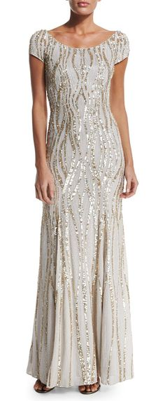 Cap-sleeve embellished gown by Jenny Packham. Jenny Packham sequined georgette gown. Round neckline; scooped back Cap sleeves. Slim silhouette. Embellished self-ti...