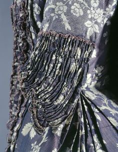 Detail of ruche end to sleeve, Robe à la française, Grenoble, 1750-1760, dismantled skirt. taffeta, silk, purple, pink and white stitching, trimmings of cream silk. Woven decoration: vertical winding garlands of foliage and flowers