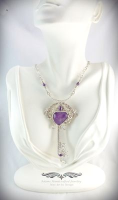"Victorian+""Key+to+My+Heart""+--+Amethyst    Enchanting+Amethyst+Heart+Key+Pendant+in+.999+Fine+Silver+w/+Faceted+Amethyst+gemstone+(.60+ct)+&+amethyst+bead+accents.+Handmade+Bar+&+Adjustable+Chain+in+Fine+&+Sterling+Silver.+Original+design+by+Daryl+Adams.    Pendant:++3+-7/8""+x+++2+-1/8"".+  Chain:..."
