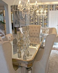 glam dining room! I am obsessed with the table, chairs centerpieces and chandelier!