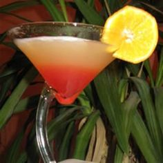 Bikini Martini - 1 fluid ounce coconut rum  3/4 fluid ounce vodka  1 fluid ounce pineapple juice  1 dash grenadine syrup  Directions  Combine rum, vodka and pineapple juice in a drink shaker. Shake firmly until frothy. Pour in a martini glass, add a touch of grenadine in the middle.