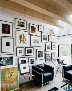 In the Sante Fe, New Mexico, home of art director Charles Churchward, the office's salon-style display includes images by Annie Leibovitz, Herb Ritts, Bruce Weber, Bill Brandt, Weegee, and others | archdigest.com