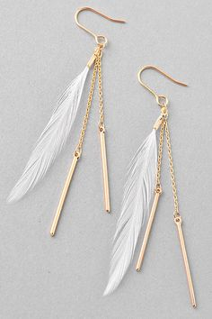 Beautiful dangle earrings featuring a light white feather and dangly bars. Gold and white. www.firstandchic.com.