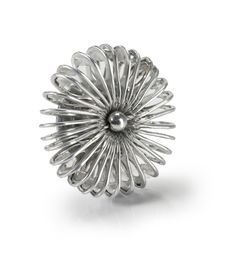 Pop Top Brooch Handmade from Recycled Aluminum by Escama Studio. Pop tops are joined with a crochet stitch done with silver thread. So creative!